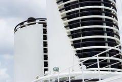 White chimneys of a large cruise ship. Close up of white chimneys of a large cruise ship Royalty Free Stock Photos