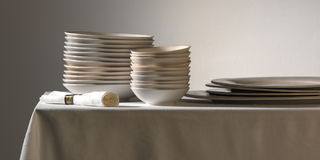 White china. On tablecloths of linen Royalty Free Stock Images
