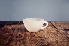 White china coffee cup on a wood table Royalty Free Stock Photography