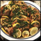 Baked trigger fish with lemons Stock Images
