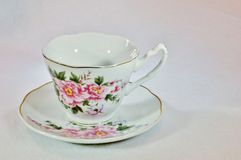 Tea cup with roses royalty free stock image