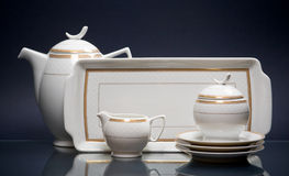 White china tea-set on blue Royalty Free Stock Photography