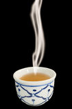 White chinese tea cup on black with smoke Royalty Free Stock Photos