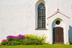 White chirch wall with window and door Royalty Free Stock Photo