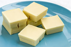 White chocolate. Candy baking squares on a blue plate Stock Photo