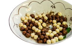White and chocolate balls for breakfast in a plate royalty free stock images