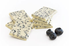 White chocolate with berries. White chocolate with blueberry fruits in front stock photo