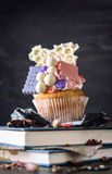 White chocolate and biscuit cup cake Stock Image
