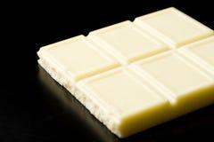 White chocolate on black Stock Photos