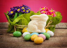 White chocolate bunny over easter eggs Royalty Free Stock Photo