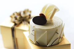 White chocolate cake. On gift box Stock Images