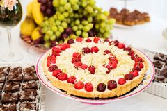 White chocolate cake with cherries Stock Image