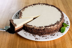 White chocolate cake. Close-up shot on a wooden table Stock Photo