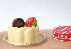 White chocolate cake with cream and strawberry on wooden background Royalty Free Stock Photos