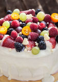 White chocolate cake decorated with fresh berries and fruits Royalty Free Stock Image