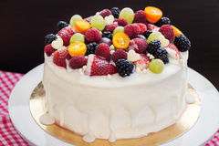 White chocolate cake decorated with fresh berries and fruits Stock Photography