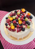 White chocolate cake decorated with fresh berries and fruits Royalty Free Stock Photos