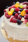 White chocolate cake decorated with fresh berries and fruits Royalty Free Stock Photography