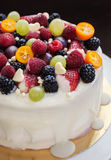 White chocolate cake decorated with fresh berries and fruits Royalty Free Stock Photo