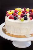 White chocolate cake decorated with fresh berries and fruits Royalty Free Stock Images