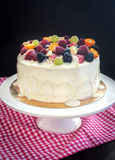 White chocolate cake decorated with fresh berries and fruits Stock Image