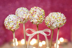 White chocolate cake pops decorated with colorful sprinkles. Stock Images
