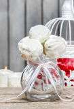 White chocolate cake pops in glass jug Stock Photos