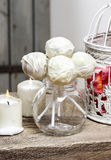 White chocolate cake pops in glass jug Stock Image