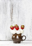 White chocolate cake pops and strawberries Royalty Free Stock Photos