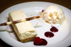 A white chocolate cheesecase with vanilla honeycomb ice cream stock images
