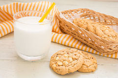 White chocolate chip cookie and milk glass Stock Image