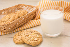White chocolate chip cookie and milk glass, Filtered image. White chocolate chip cookie and a milk glass, Filtered image stock images