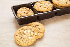 White chocolate chip with raspberry cookie and plastic box Stock Image