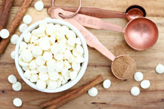 White Chocolate Chips & Measuring Spoons Royalty Free Stock Images