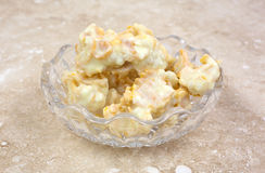 White chocolate clusters in dish Royalty Free Stock Images