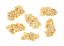 White Chocolate Clusters Group Five. A group of five delicious pieces of chewy and crunchy white chocolate clusters of candy Royalty Free Stock Photo