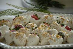 White chocolate covered strawberries royalty free stock images