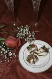 White chocolate covered strawberries, rose and champagne. Valentine`s day table. Chocolate dipped fresh strawberries, single red rose, champagne in crystal stock images