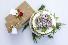White Chocolate Cranberry Cake with gift boxes on table cloth Stock Photography