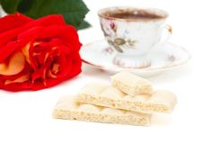 White chocolate, a cup of coffee, rose Royalty Free Stock Photo