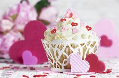 White Chocolate Cupcake with Hearts and Flowers stock photo