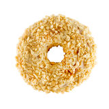 White chocolate donut sprinkled with nuts. Isolated on white background Stock Image