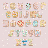 White chocolate donuts font. Artistic alphabet Stock Image