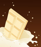 White chocolate falling in milk Royalty Free Stock Photo