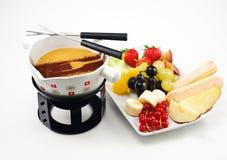 White chocolate fondue with cinnamon Stock Image