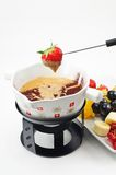 White chocolate fondue with cinnamon Royalty Free Stock Images