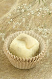 White chocolate homemade truffles with nut on golden background with flower Royalty Free Stock Photo