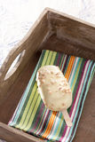 White chocolate ice-cream on a stick Stock Photos