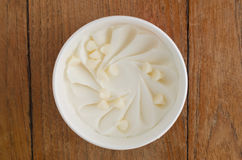 White Chocolate Italian ice cream tub. Overhead view of  homemade White Chocolate Italian ice cream tub on wooden background Royalty Free Stock Photography
