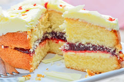 White chocolate jam and cream sponge cake Royalty Free Stock Images